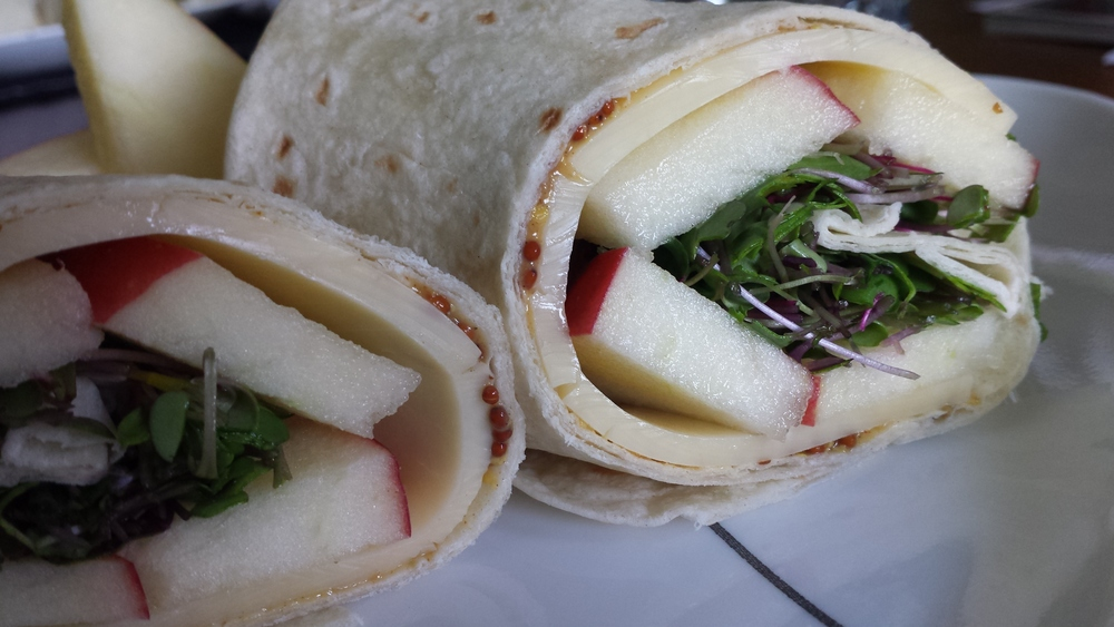 They added a crunchy layer in a sandwich wrap filled with sliced apples, cheddar cheese, and whole-grain mustard.