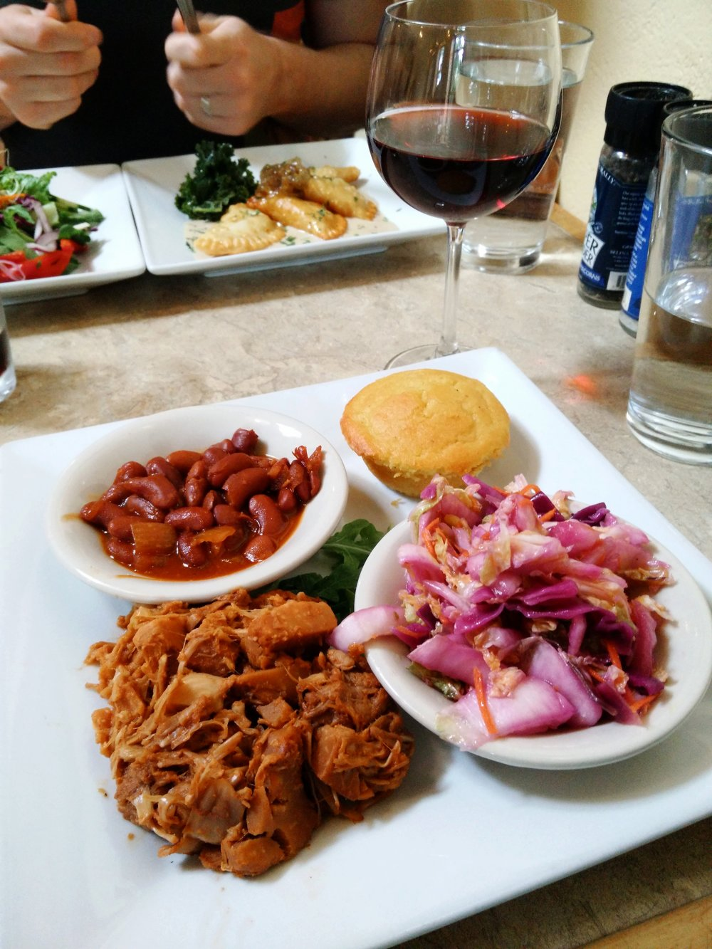 The Laughing Seed's barbecue platter: vegan chipotle beans, cornbread muffin, tangy Southern slaw, and BBQ jackfruit