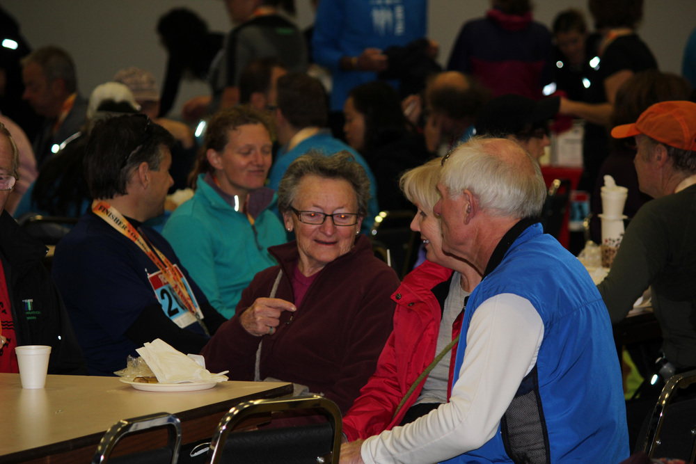 The young and the young at heart enjoying pancakes and conversation in the comunity hall after the race.