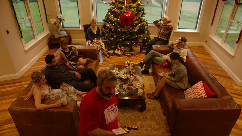 BTS - Cast at Tree w Director Craig Anderson  - Red Christmas Photo by Douglas Burdorff.jpeg