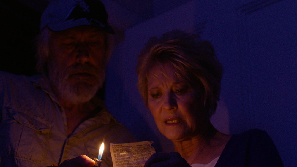 Dee Wallace and Geoff Morrell - Red Christmas Photo by Douglas Burdorff.jpeg