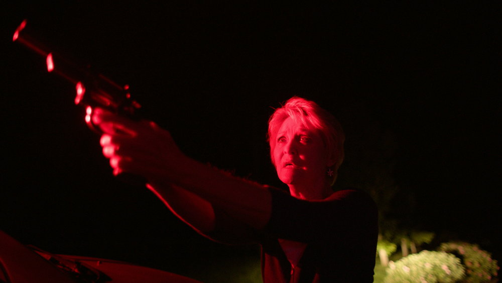 Dee Wallace with Gun in Red Light - Red Christmas Photo by Douglas Burgdorff.jpeg