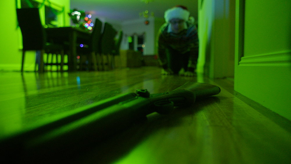 Gerard O'Dwyer crawls to a gun - Red Christmas Photo by Douglas Burgdorff.jpeg