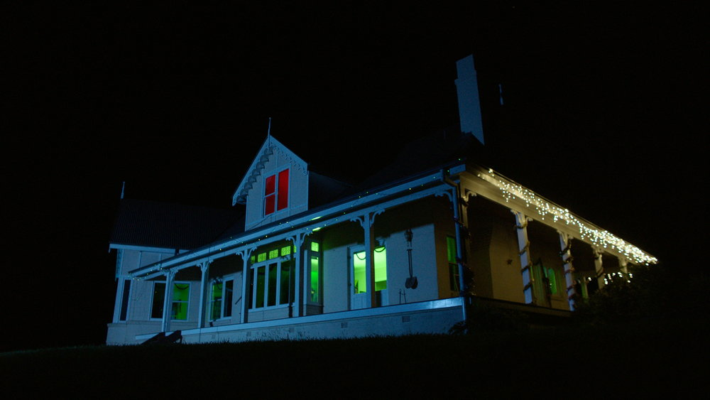 House Exterior Night - Red Christmas Photo by Douglas Burgdorff.jpeg