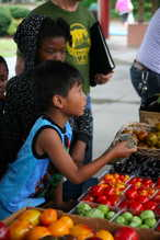 children buying tomatoes