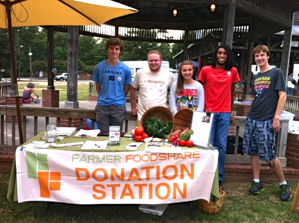 Carrboro High Donation Station Club staffing the Wednesday farmers market in Carrboro