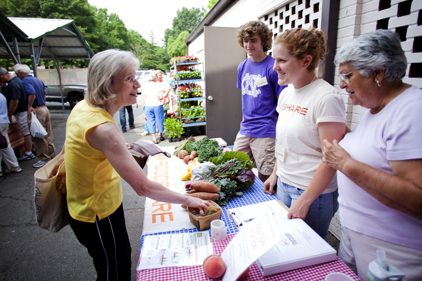 Volunteers and shopper at the Donation Station – Photo by Hannah Sharpe