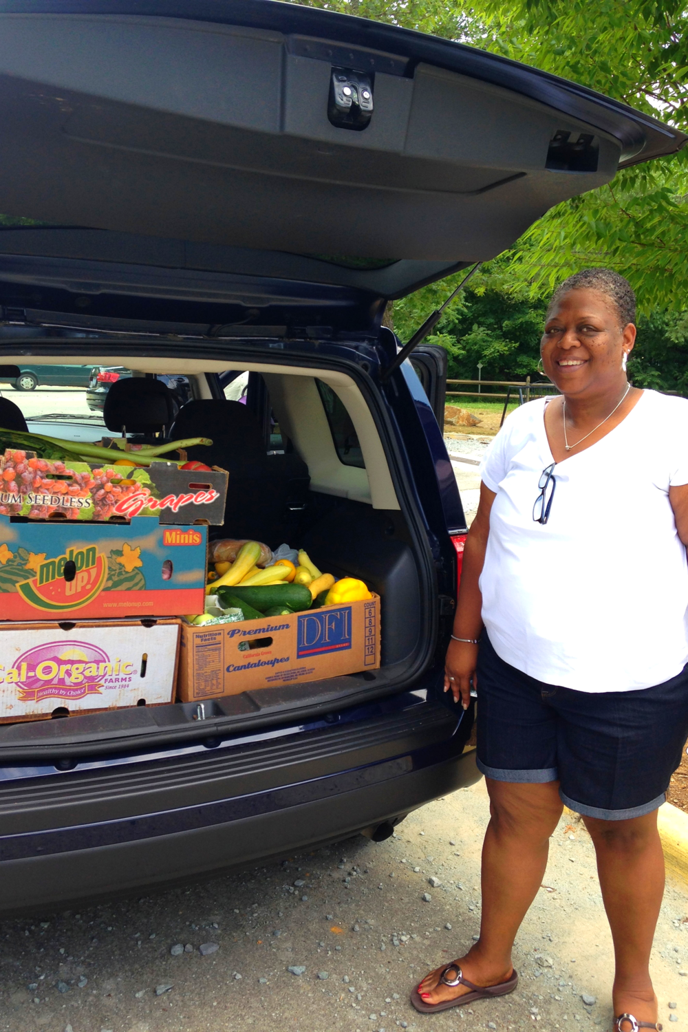 Darlene with the food all loaded up for local families