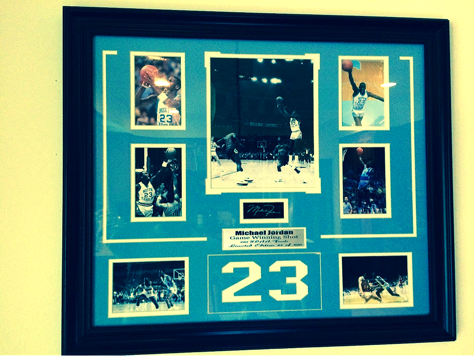 Signed and framed collection of souvenir photos of Michael Jordan - #23/500! A beautiful tribute, capturing him in seven iconic photos, including his 1982 game winning shot.  This is a limited edition---lucky number 23 of 500.   Provided by: Laura Kayser
