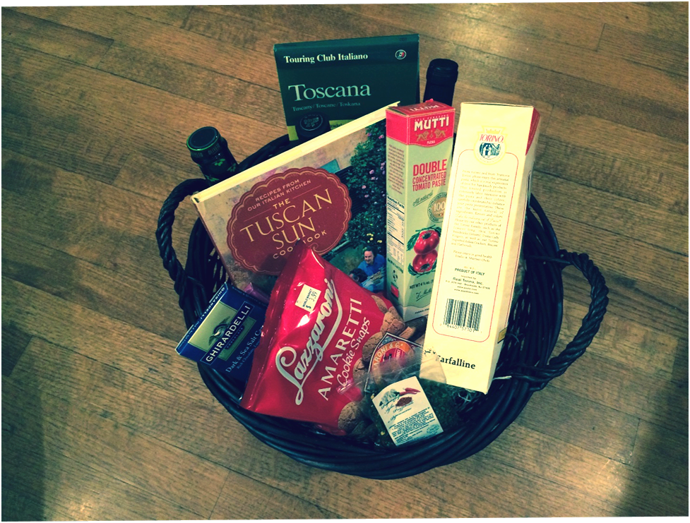 Welcome to Tuscany Basket Take a tour of Tuscany with this lovely gift basket, featuring: The Tuscan Sun Cookbook (compliments of Flyleaf Books), Tourino pasta, concentrated tomato paste, olive oil and balsamic vinegar, a Touring Club Italiano roadmap, two lovely bottles of Italian wine, Amaretto cookie snaps, and two bars of Ghirardelli chocolate. Provided by:Laura Kayser