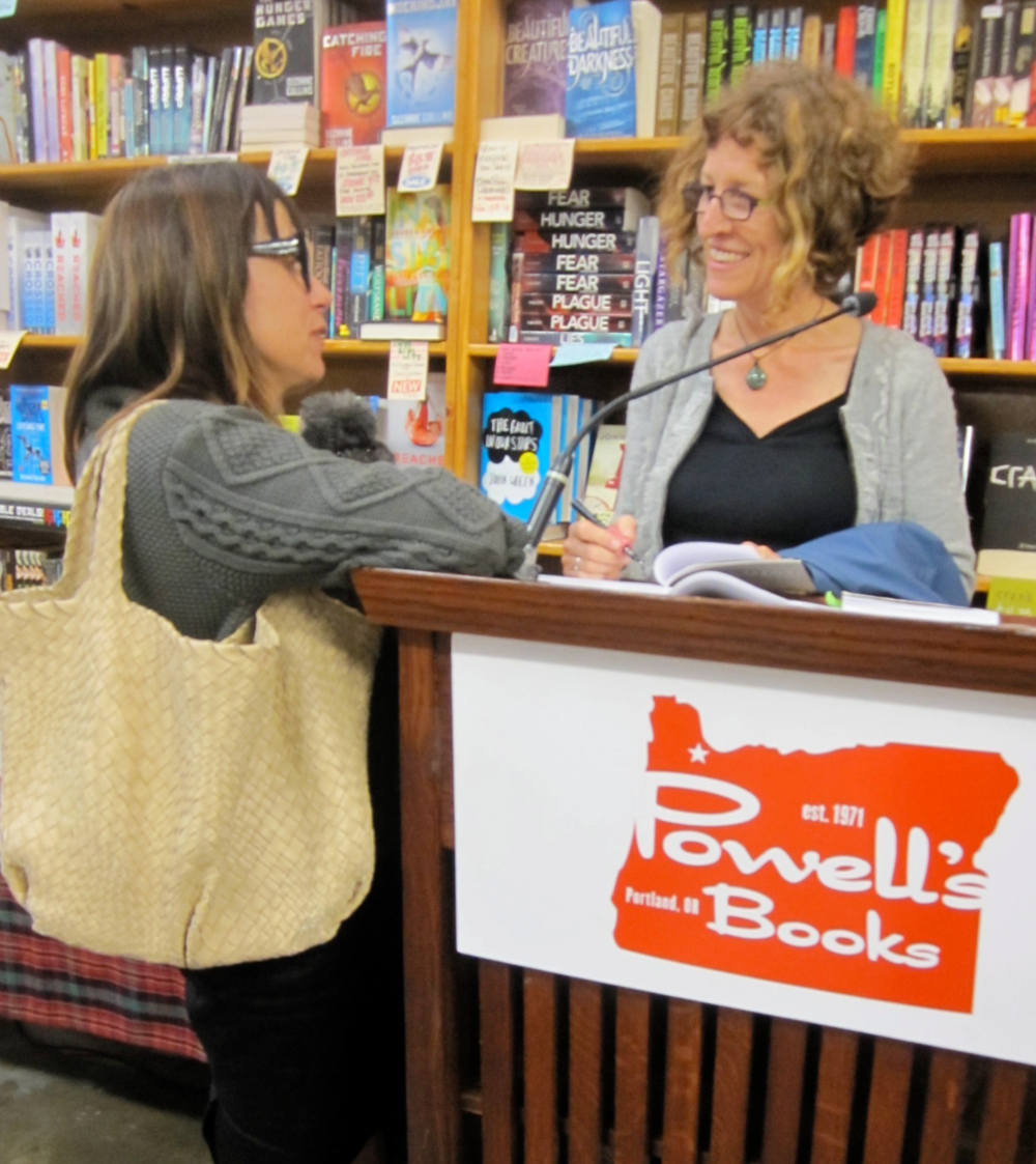 Monica signs copies of Holding Silvan  at Powell's Books in Portland, May 2013