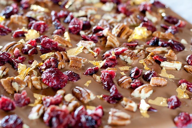 Roasted pecan, dried cranberry and gold leaf milk chocolate bark