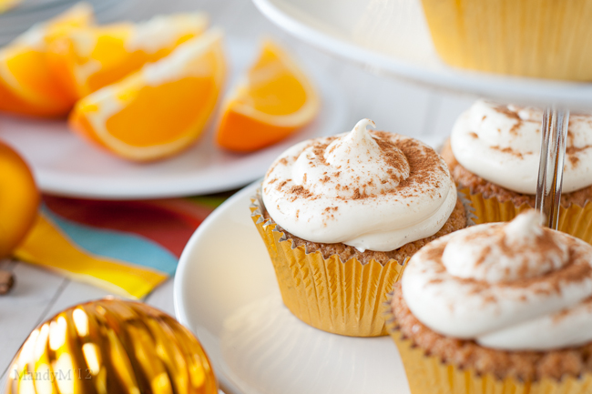 Tangy orange cream cheese frosting dusted with cinnamon