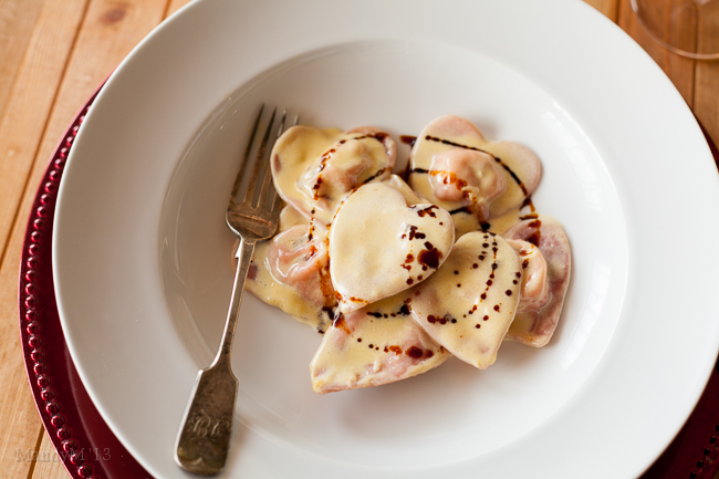 Pink pasta hearts filled with ricotta and sundried tomatoes, smothered in white wine cream sauce and a drizzle of balsamic vinegar