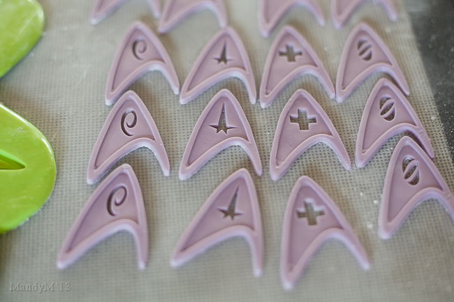 Gumpaste badges before spraying with edible silver lustre spray
