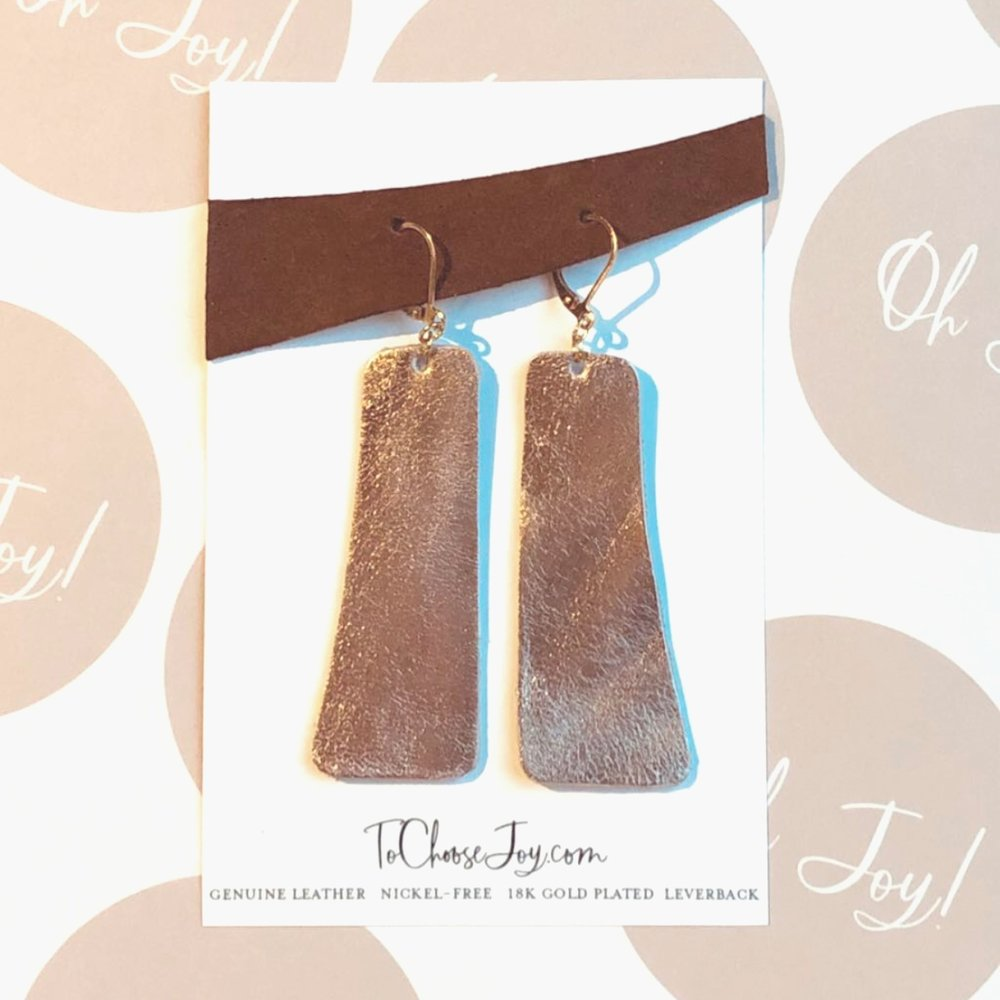 Find handmade leather earrings in the Shop.