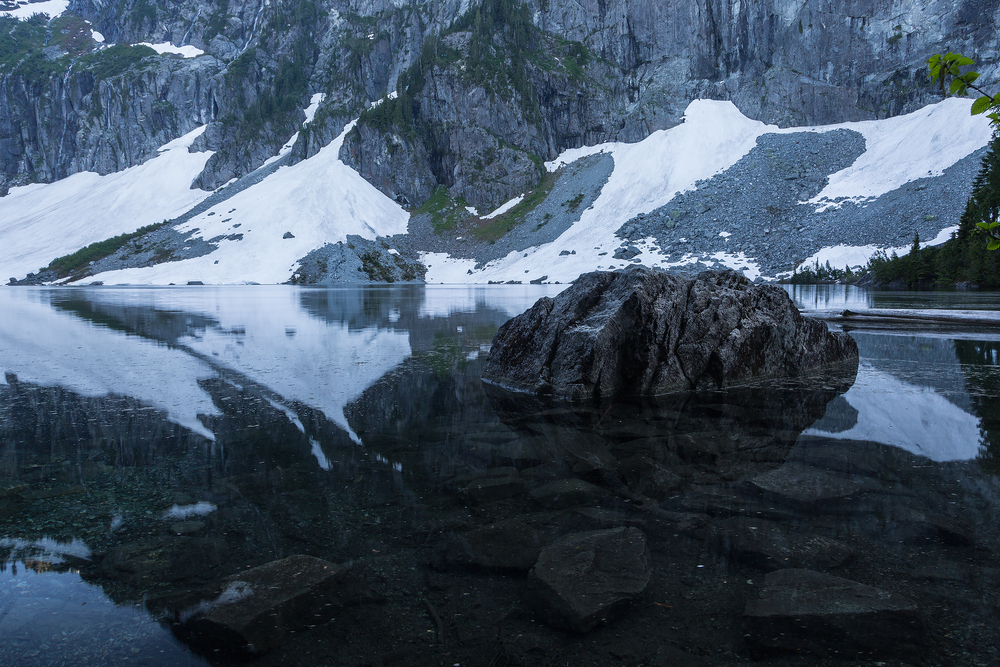Lake Serene lies underneath the cliffs of the summit of Mount Index in Washington state.