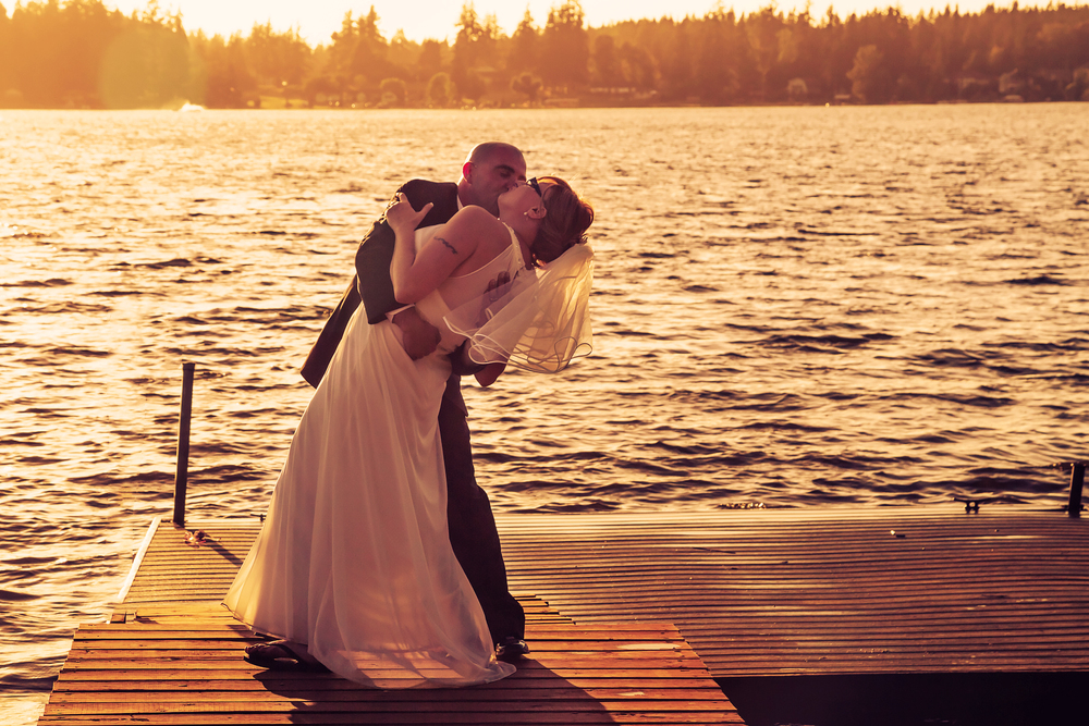 We asked if they would go out onto the dock to take some nice silhouette pictures. Even while we were setting up, their feelings for each other were amazing to behold. Little did we know what would take place only moments later!