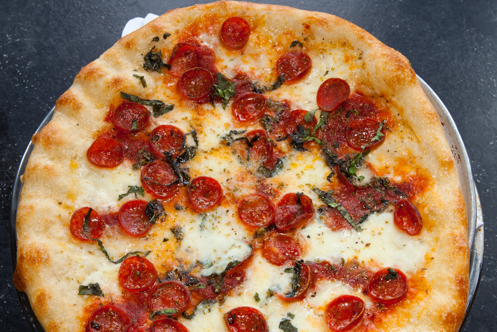 NEW YORK STYLE PIZZA  Our Margherita pizza is made with fresh mozzarella, roasted Roma tomatoes, Pecorino Romano, olive oil, & fresh basil