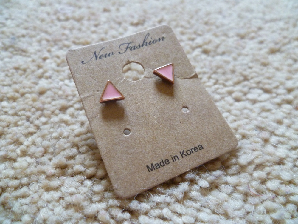 A cute pair of pink triangle shaped earrings that I picked up for really cheap in Camdon