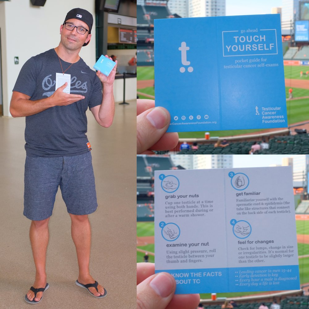 Dr Pierorazio handing out pocket testicular cancer guides at the Baltimore Orioles game