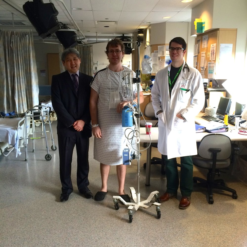 December 2014 - Alex had two lung surgeries. The gentleman To Alex's right is Dr. John Yee, Alex's thoracic surgeon. Dr. Yee has just told Alex that he is being released from hospital.