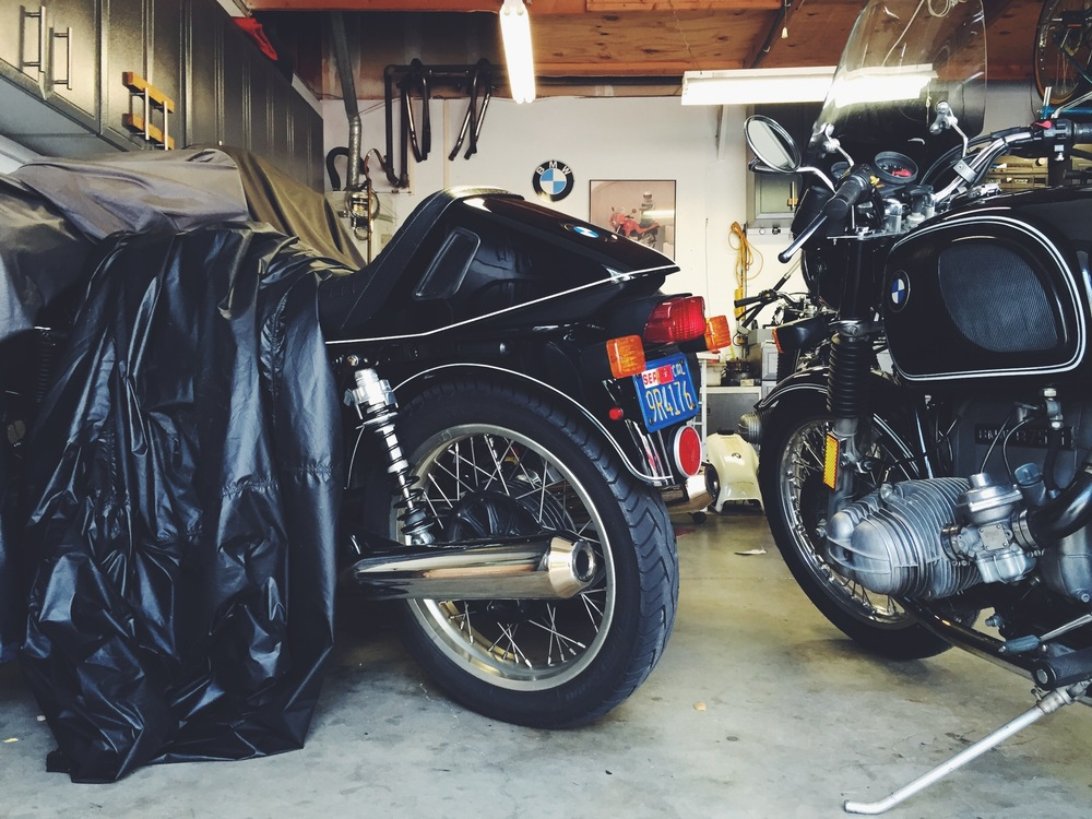"Mark's first airhead under the cover, he calls it ""Joe Black"". It started as a R90S, but its been converted too many times with hot parts. Another one of his personal favorites is his 1976 R75/6."