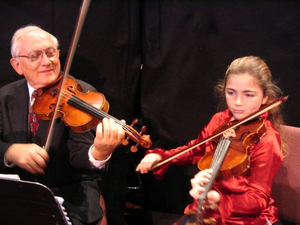 Dr. John Enyart and His Granddaughter Performing
