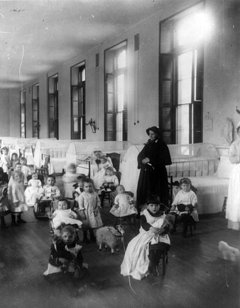 Sister Irene of New York Foundling Hospital with children. Sister Irene  is among the pioneers of modern adoption, establishing a system to board  out children rather than institutionalize them.  Photo By Jacob Riis,  1888, Library of Congress