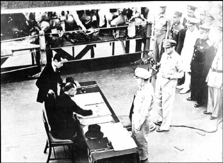 Japanese Foreign Minister Mamoru Shigemitsu signs the Instrument of Surrender on behalf of the Japanese Government. At 9:04 a.m. on Sept. 2,1945, aboard the battleship USS Missouri in Tokyo Bay, World War II ended. (Army Signal Corp)