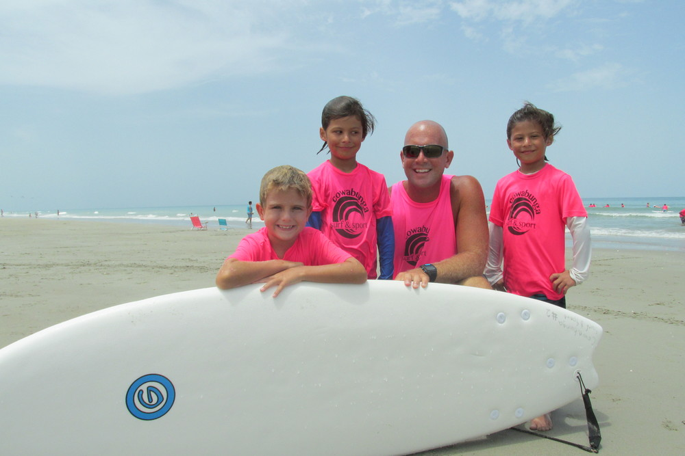 Brett Jenkins with Beginning Surfers at Jensen Beach
