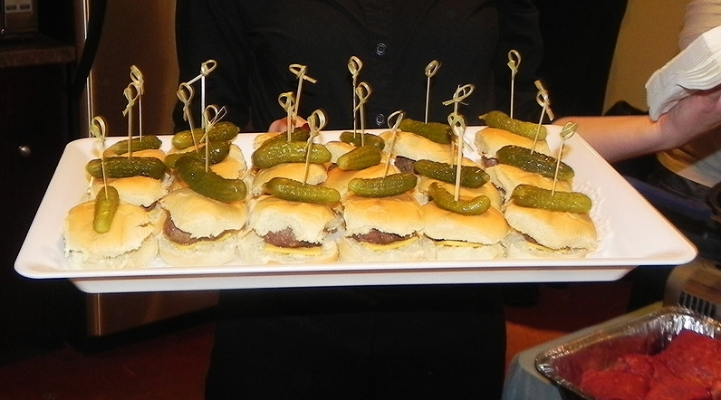 Mini Beef Sliders Topped With A Mini Pickle
