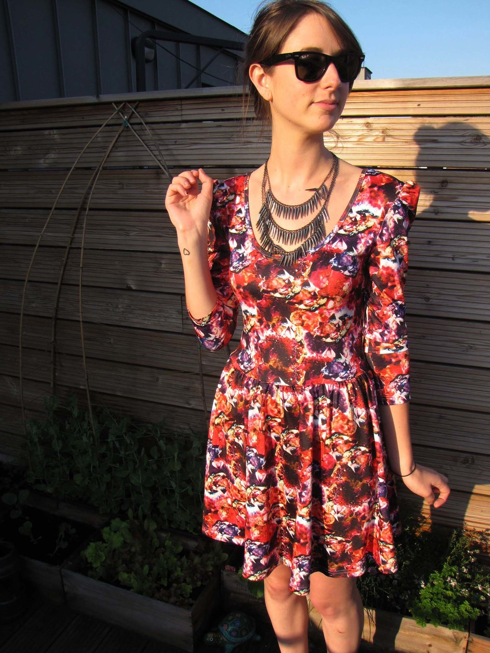 Lisa Williams wearing Whistle & Wolf Jewel Print Skater Dress.