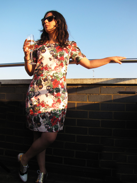 Tatiana wearing Whistle & Wolf Garden Print Dress.