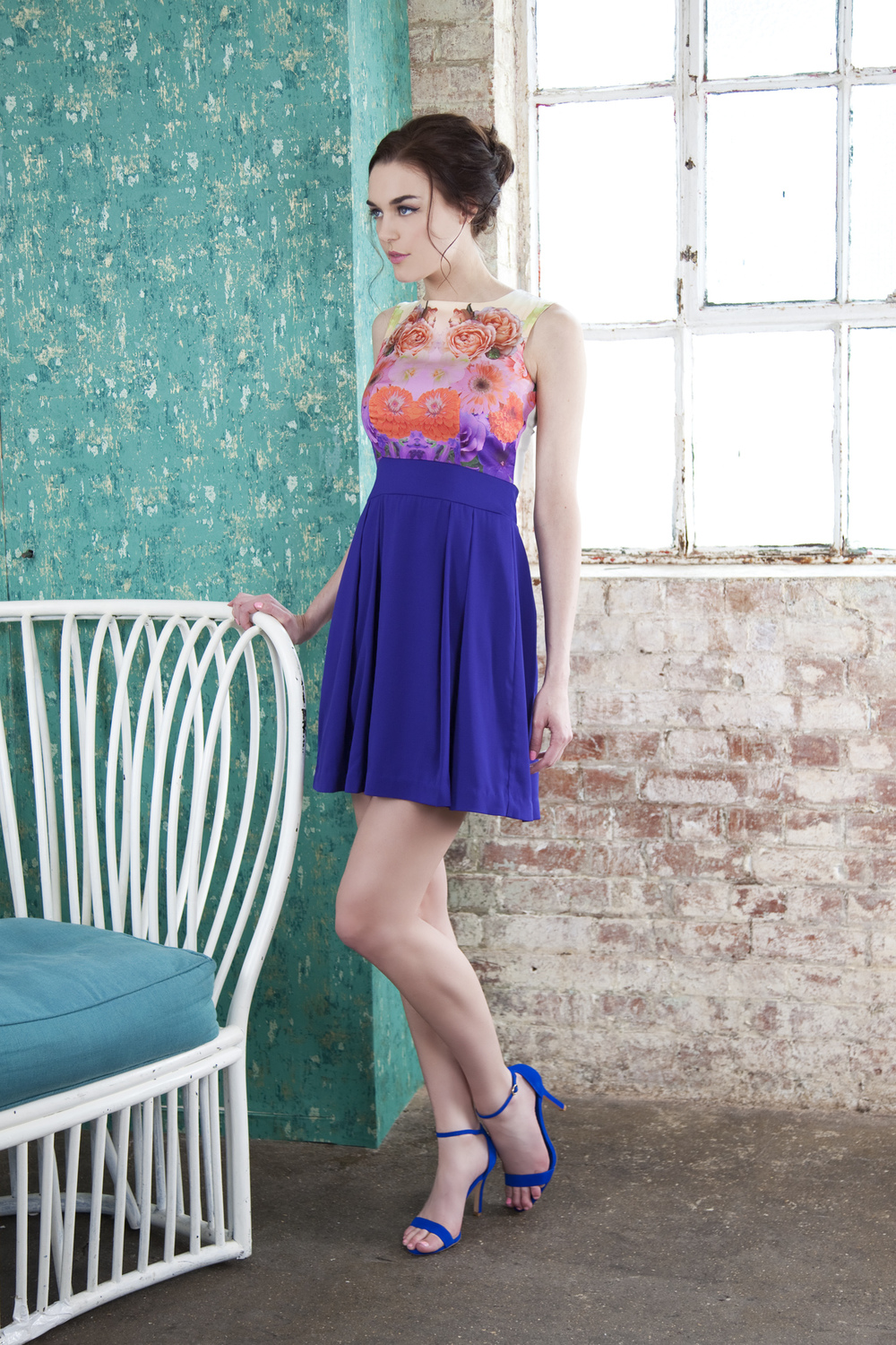Contrast dress with a floral placement print bodice and full skirt.