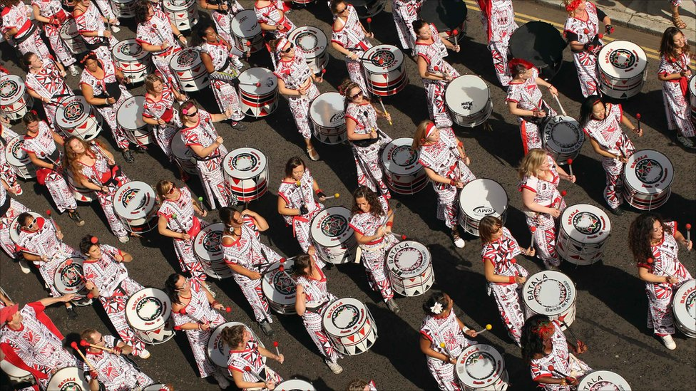 Procession of steel drummers during the parade, 2013