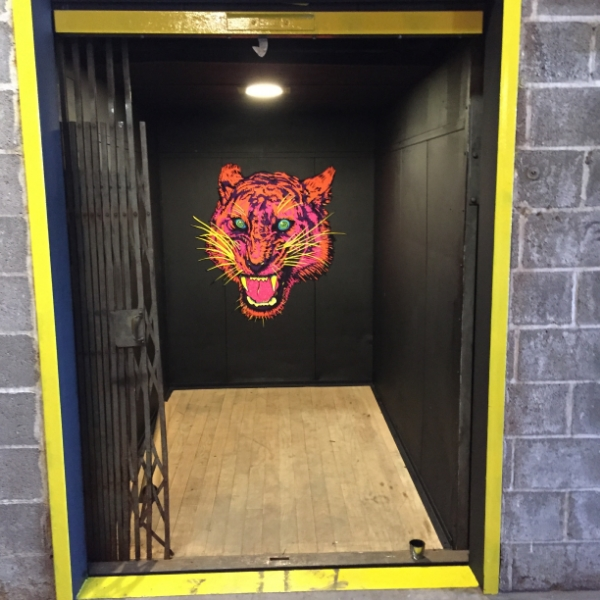 Vinyl sticker of the tiger from my 'BLACK ACID' label. This is in the freight elevator at 18th Street Brewery's Hammond brewpub.
