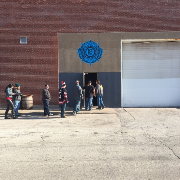 The first people in the door of the 18th Street Brewery Hammond brewpub on opening day. Note the 6ft logo mural above the door.