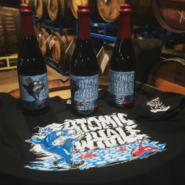 Atomic Whale merch and bottles. This was a collab we did with Mikkeller in conjunction with the Mikkeller Running Club and our own group, Local One Eight.