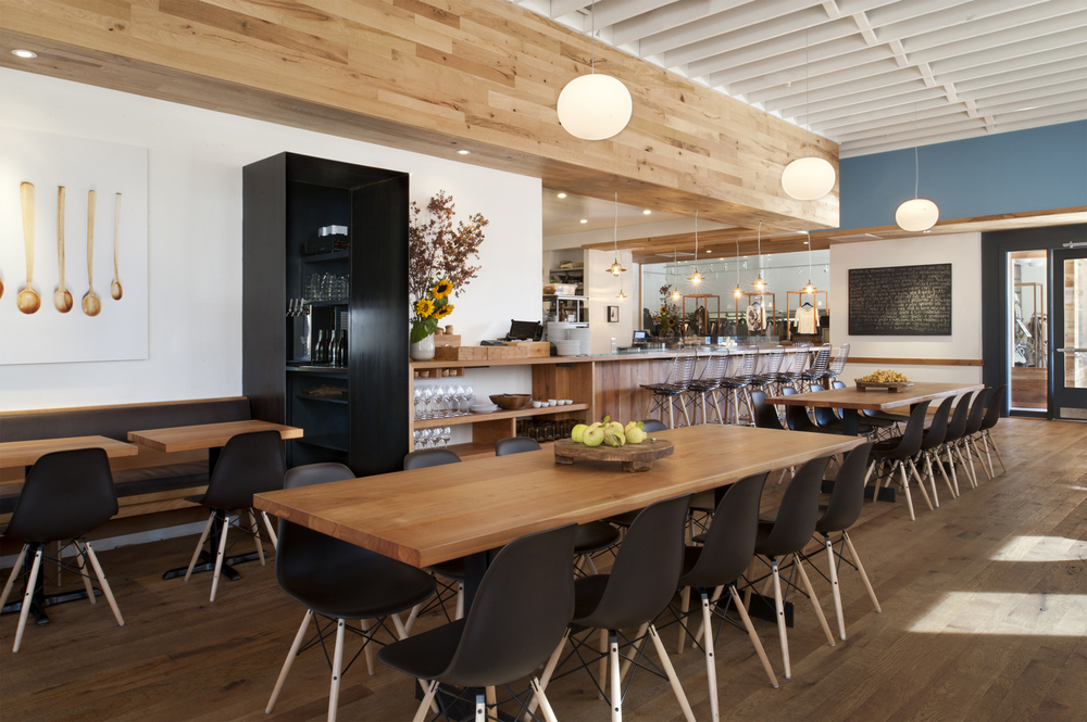 Situated within the San Francisco neighborhood of Dogpatch, Piccino Restaurant is housed in what was once a sprawling Victorian barn.  The interiors retain a rustic flavor while exuding a crisp freshness with exposed white rafters, reclaimed black oak floors and modern touches such as Eames chairs and stools.