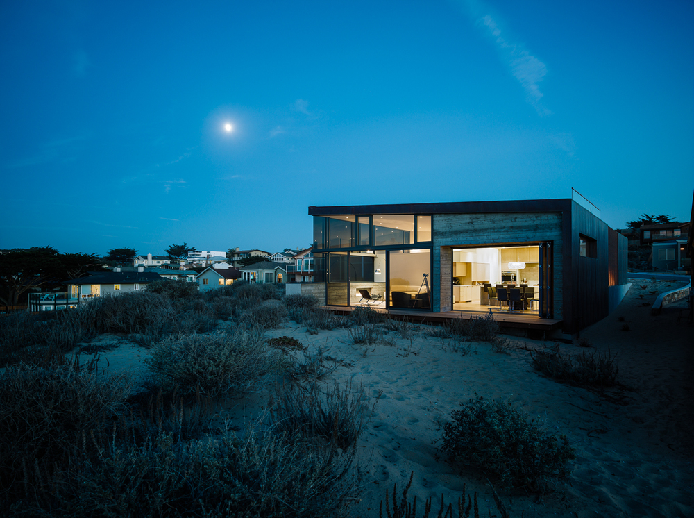 Achieving a balance of airy openness and privacy, this 2,700 sf beachfront property slips neatly into a wedge on California's striking Monterey coast.  The open floor plan with master bedroom loft allows unrestricted views of the Pacific Ocean throughout.  Large sliding and bi-folding glass doors open interior living areas directly onto the sand.