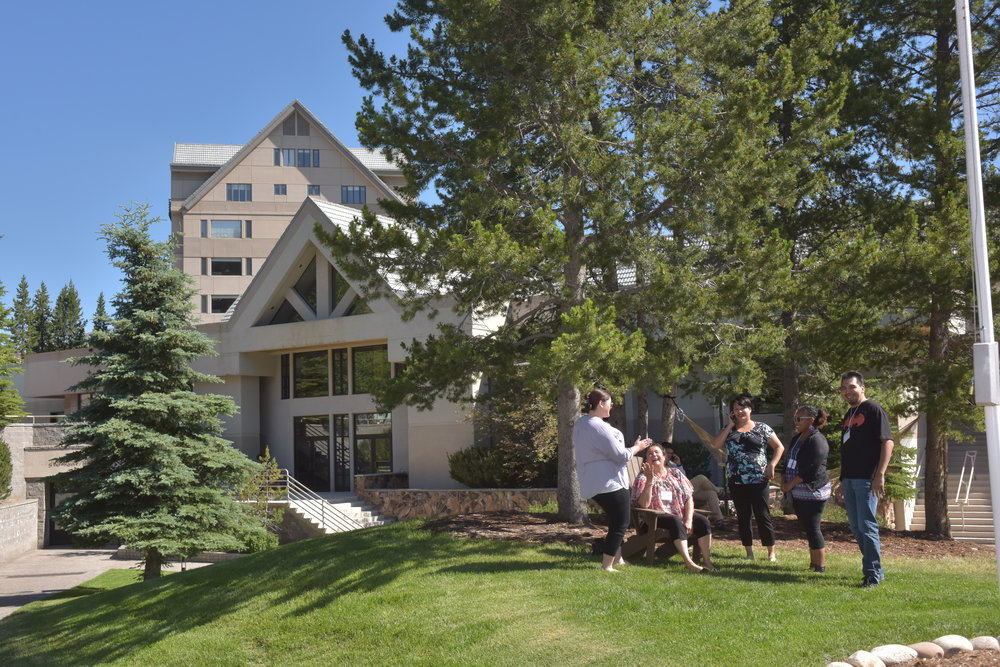 MSI participants talk outside the yellowstone conference center at big sky resort.