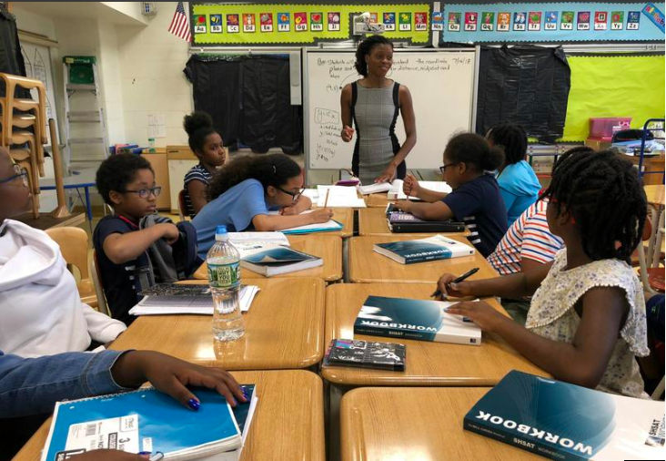 Tai Abrams teaches students enrolled in the 2018 AdmissionSquad SHSAT summer boot camp hosted at PS 66, a Brooklyn middle school  Story by Beenish Ahmed, WNYC News