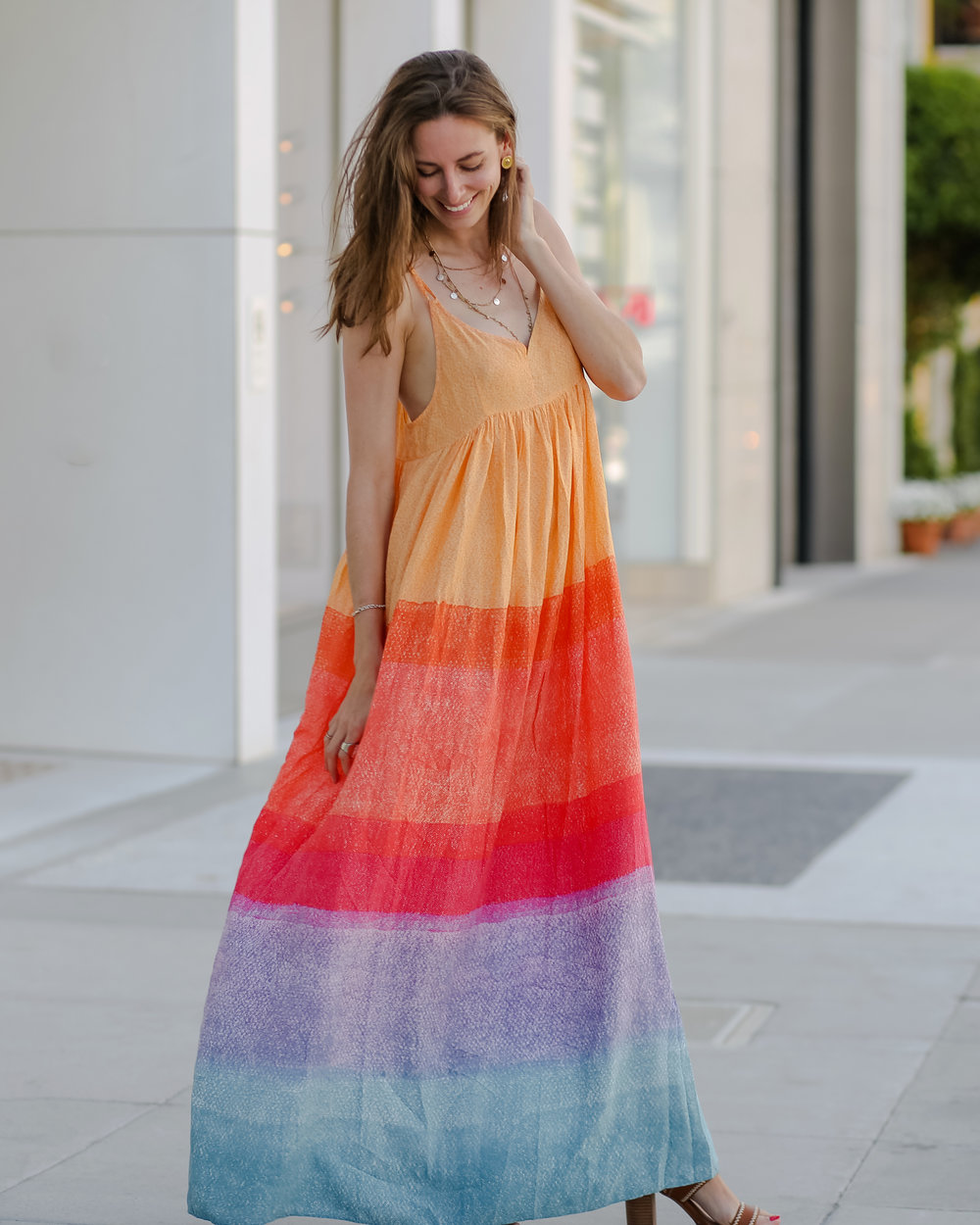 5f9fe5c2e92 I love this rainbow splashed maxi dress from Anthropologie because it  reminds me of my carefree days on the island. From snow cones to the state  license ...
