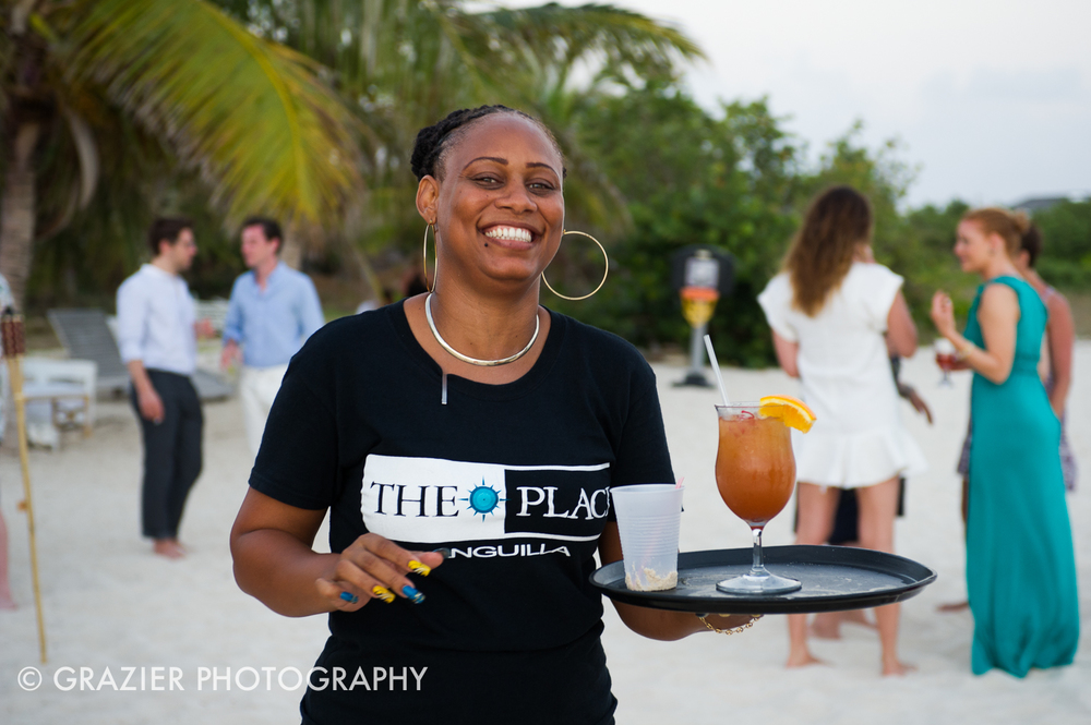 Rum punch served with a smile at  The Place , Rendezvous Bay, Anguilla