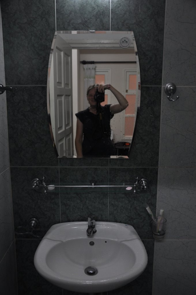 Snazzy bathroom with NO ventilation and a funny smell.
