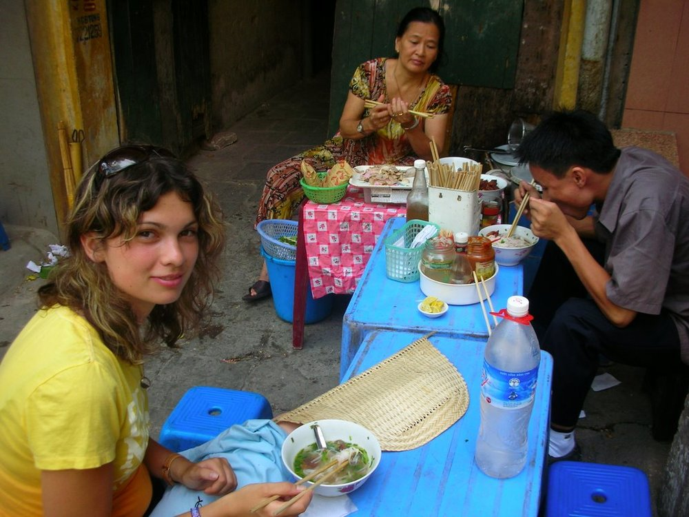 This Is me and our Plan translator having some breakky at a pavement food stall, these are everywhere in Vietnam.