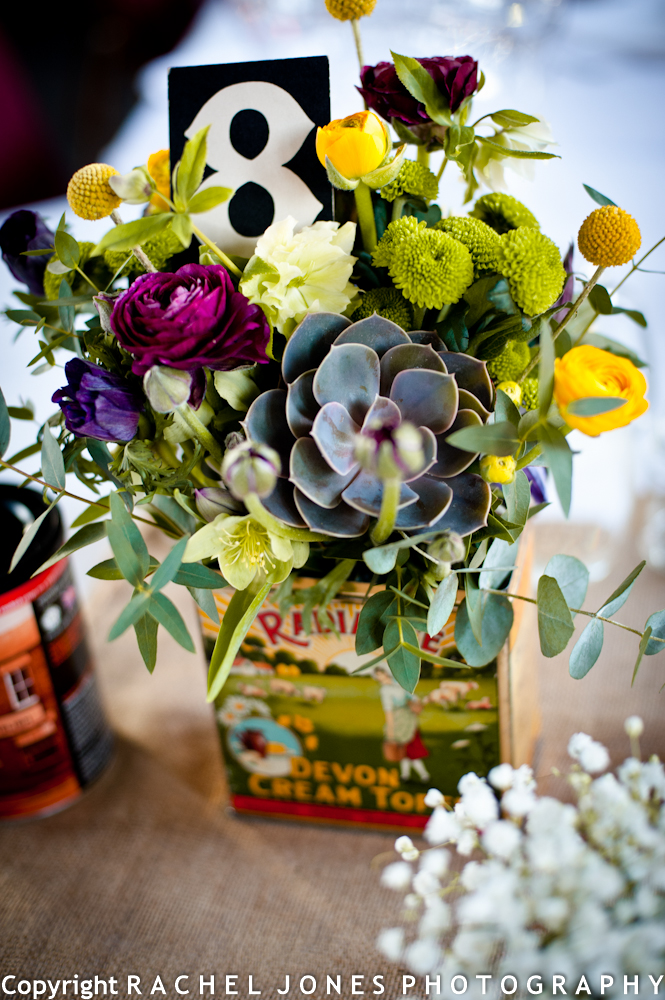 Lovely vintage touches included these pretty table centres using vintage tins