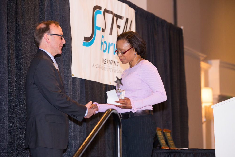 American Transmission Company  (ATC) received the 2019 Spirit of STEM Award. Accepting the award on behalf of ATC is Juanita Banks, Vice President of Audit & Risk Management.