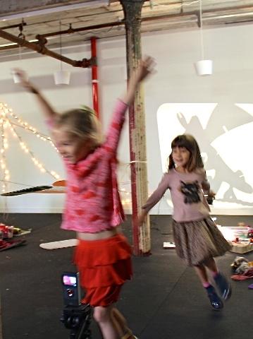 Arms reaching upward as the children take flight.